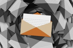 An opened letter, representing communication over email.