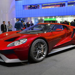 A red Ford supercar, which features a digital dashboard.