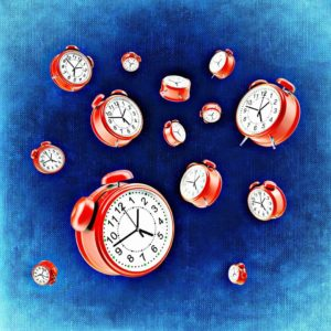 Alarm clocks, representing the constant phone distractions that can prohibit work