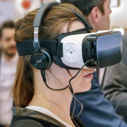 A girl wearing an oculus virtual reality headset